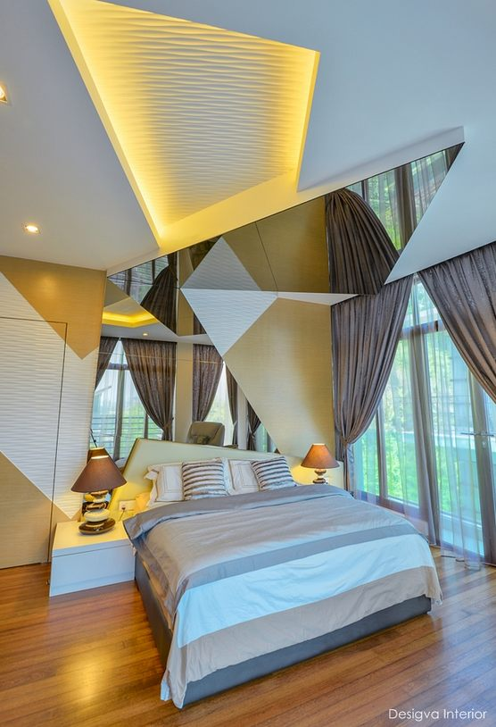 Angles and mirrored bedroom for semi-d in Anjung Tiara, Segambut by Desigva Interior. Source