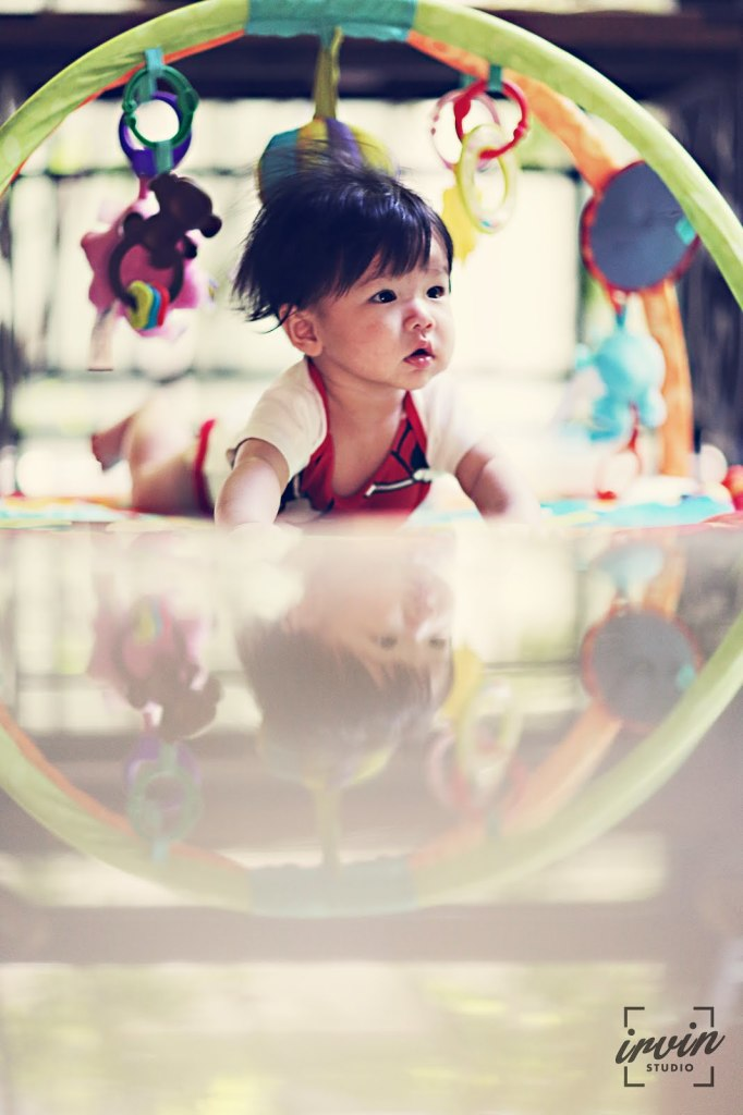 Lots of toys to keep baby occupied. Photo by Irvin Studio