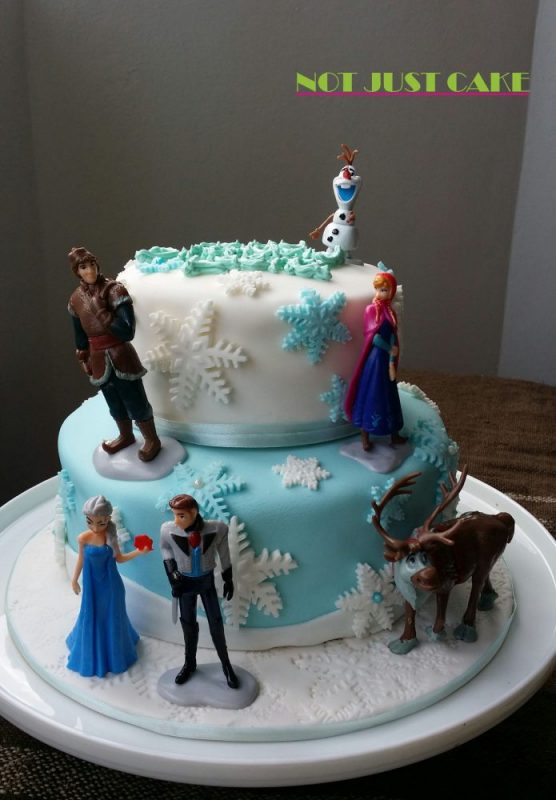 Two tier frozen cake with toppers