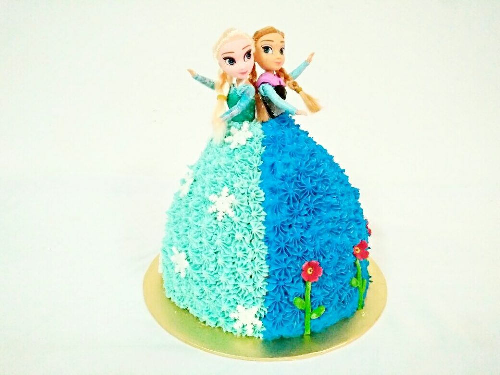 Elsa and Anna doll cake. By Eats and Treats. Source