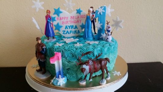 Buttercream rosettes cake with frozen theme and toppers. By Celebrate With A Cake. Source