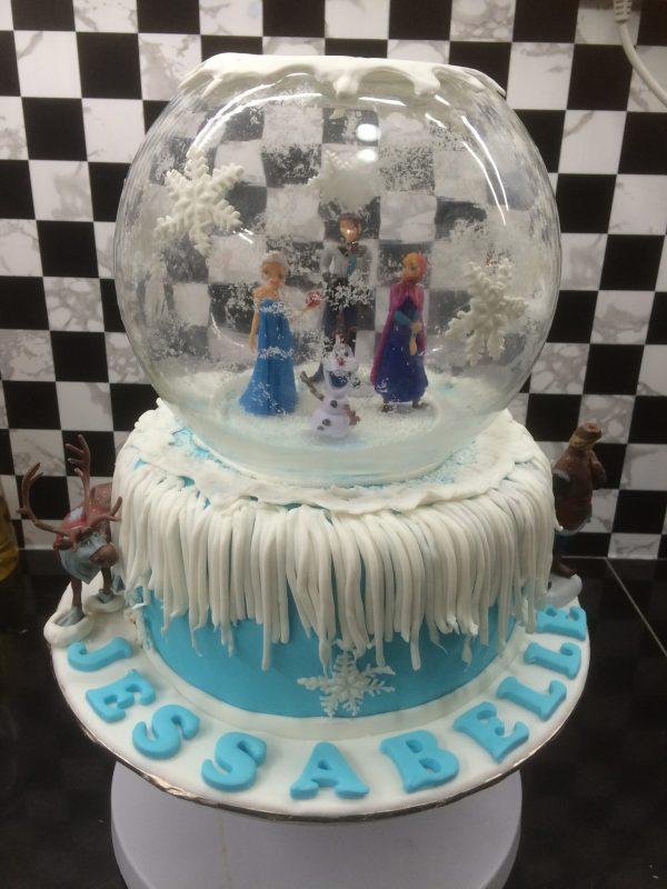 Frozen theme cake snowglobe design by Shaniel Cake Artistry