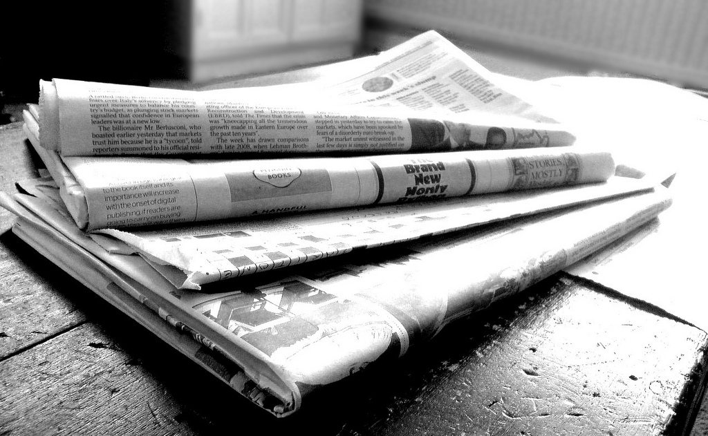 A pile of newspapers out front is a sure sign you're not at home. Photo by Flickr user Jon S