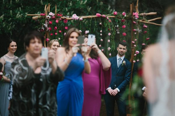 Overenthusiastic wedding ceremony guests with their mobile phones. Photo by Thomas Stewart Photography.