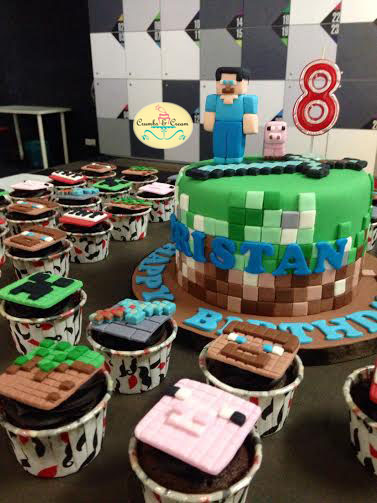 Steve, mini pig and sword Minecraft cake, with assorted Minecraft cupcake designs by Crumbs and Cream
