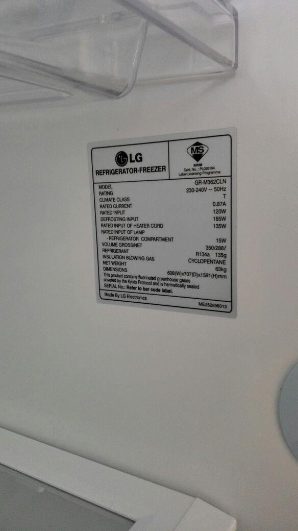 Checking the power consumption label for a fridge-freezer. Photo by Zarul's Washers & Fridges. Source.