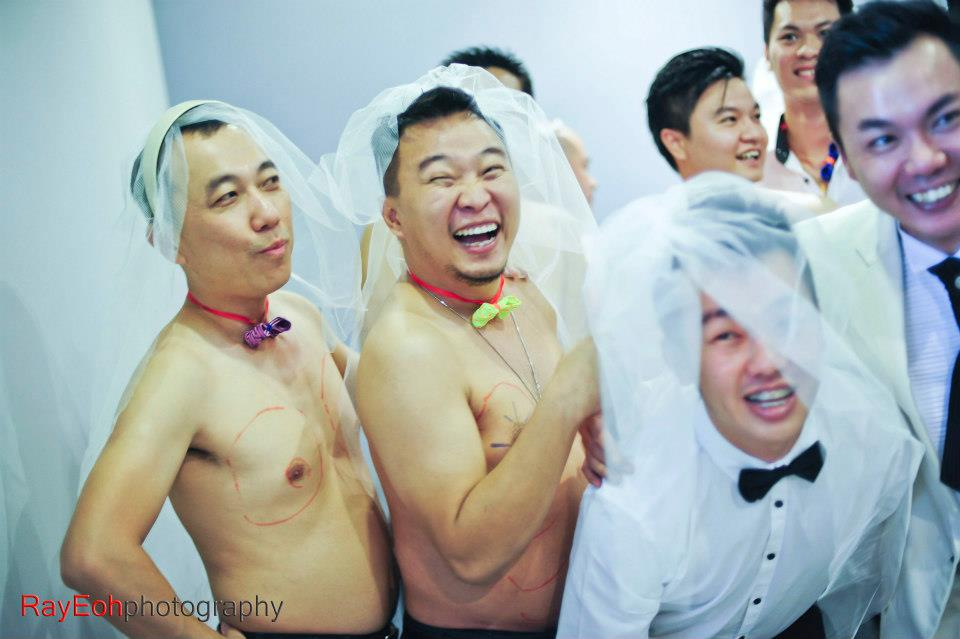 Just before the plastic surgery session. Wedding gatecrashing games photo by Ray Eoh Photography
