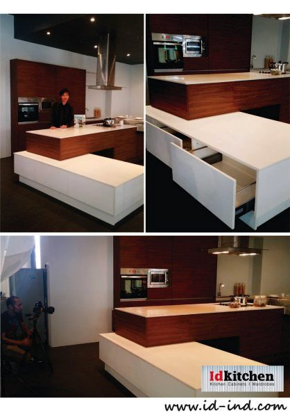 Multi-level kitchen cabinet design in wood and white. Id Kitchen. Source.