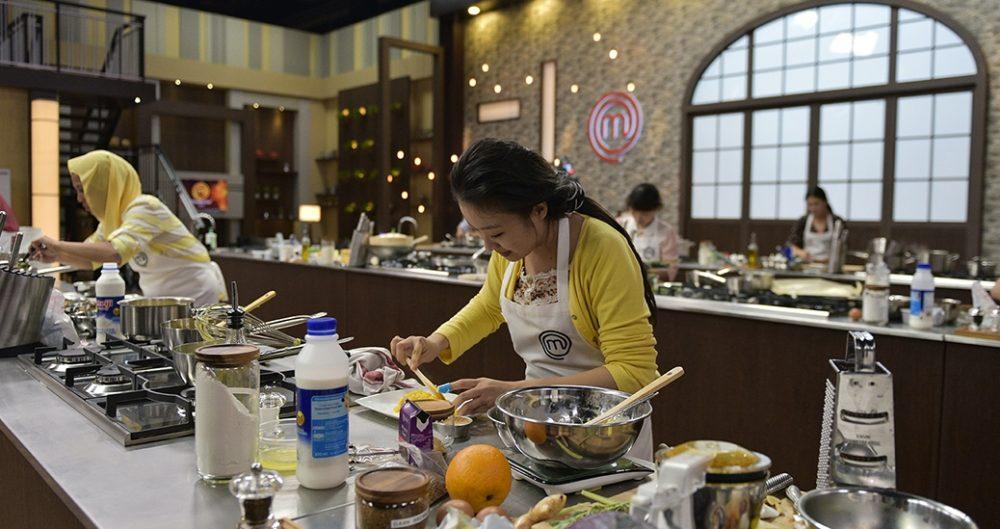 Above: Masterchef Asia kitchen cabinet design with dark brown cabinets and stainless steel worktop. Source