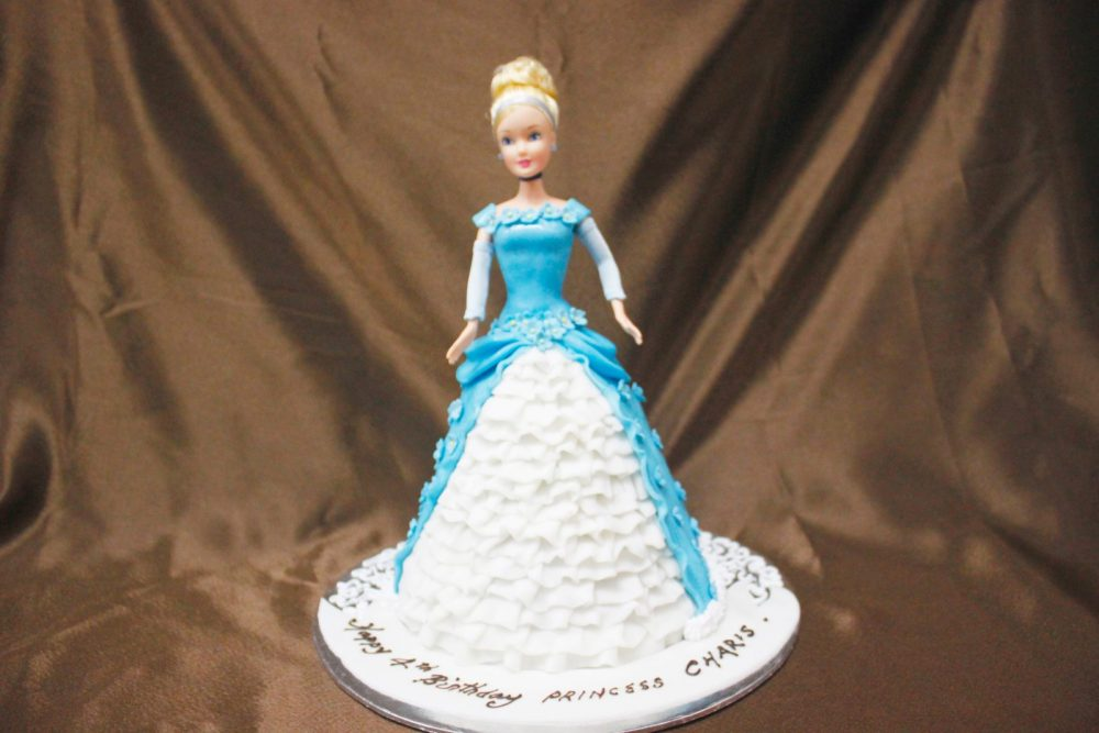 Elsa-themed doll cake in blue. Made by: Temptations Cakes. Order in Singapore at Recommend.sg