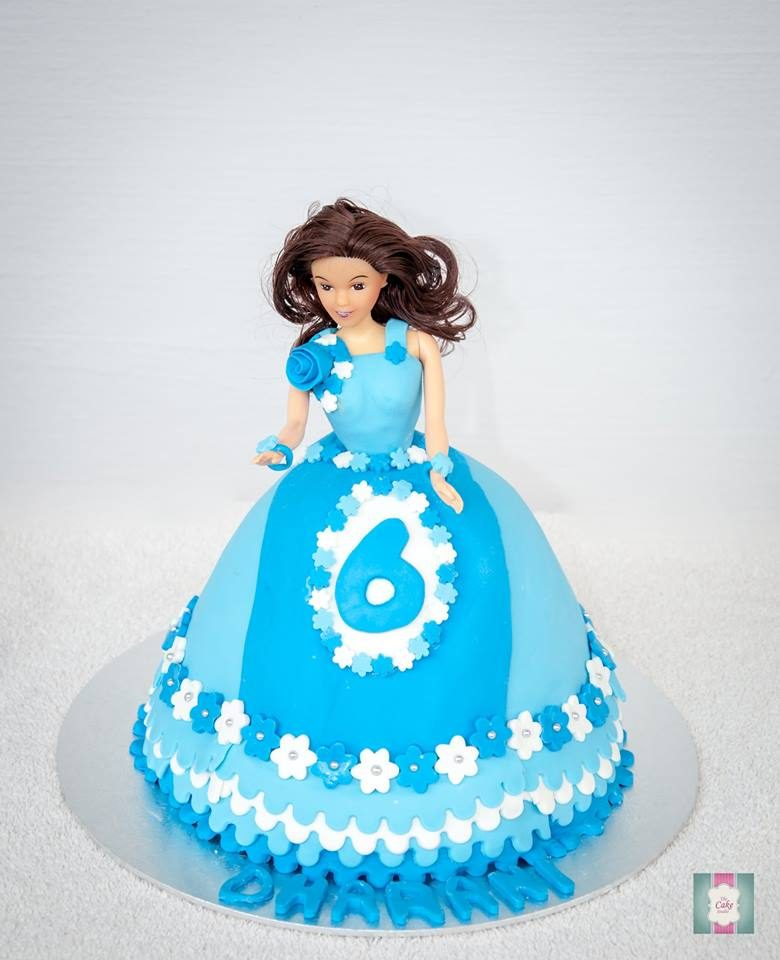Doll cake with blue gown. Made by: The Cake Studio SG. Order in Singapore at Recommend.sg