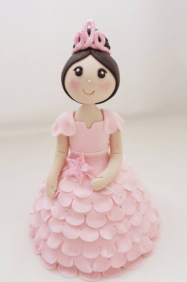 Pink doll cake with tiara and ruffles. Made by: Little House of Dreams. Order in Singapore at Recommend.sg