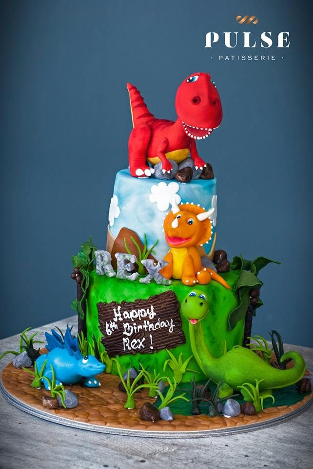 Two-tiered Dinosaur cake with jungle scene by Pulse Patisserie