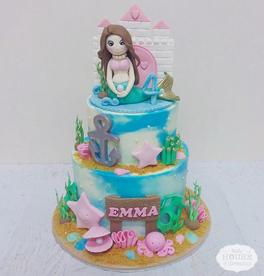 Two-tier Little Mermaid themed cake with Ariel and undersea scene. Made by: Little House of Dreams. Order in Singapore at Recommend.sg