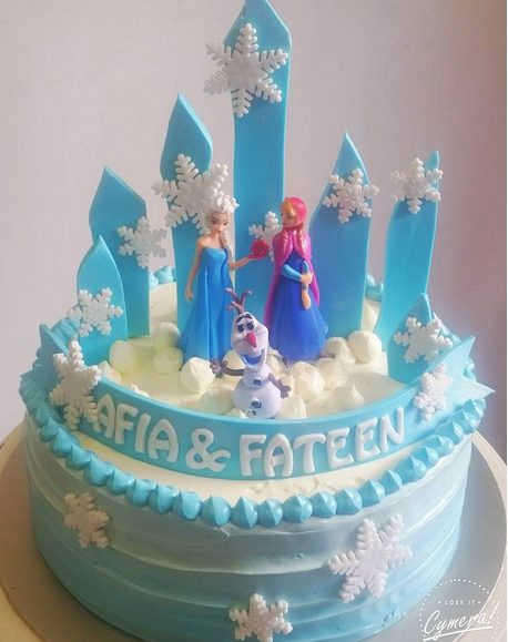 Ribbons, towers and snowflakes Frozen cake by BakedByIn
