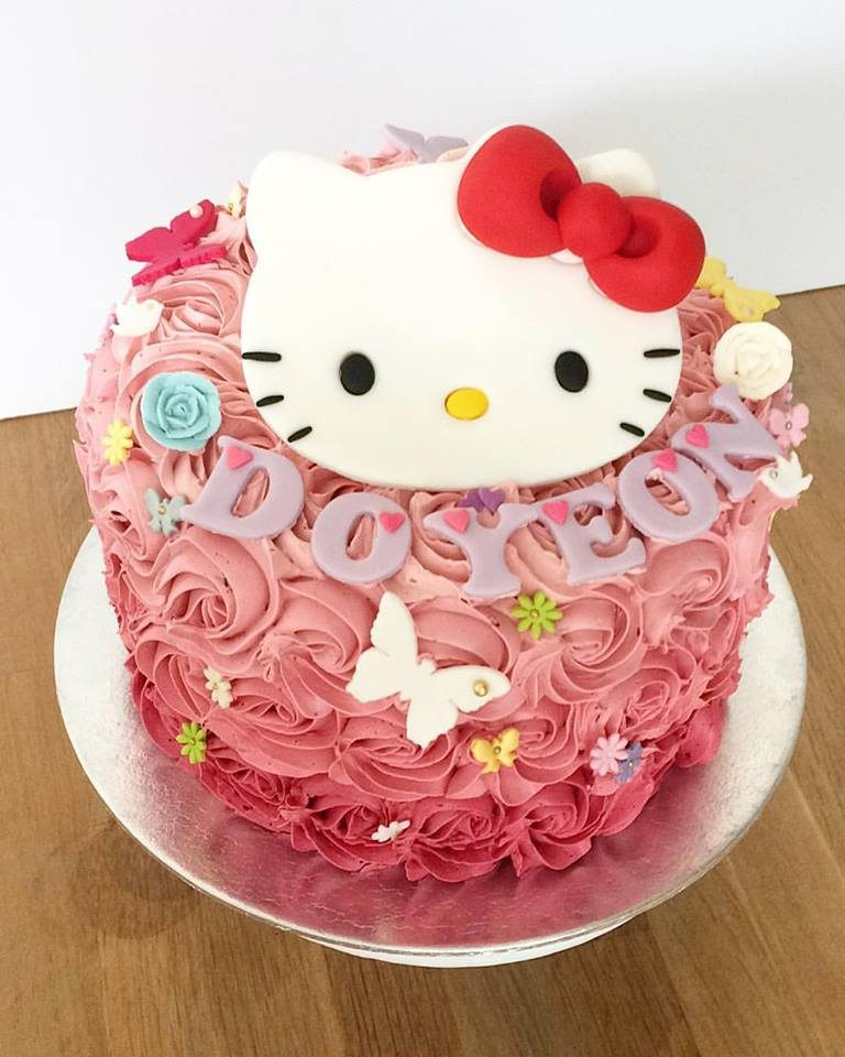 Turn any regular buttercream frosted cake into a Hello Kitty themed cake by adding a Hello Kitty fondant cutout. Made by: Oni Cupcakes. Source