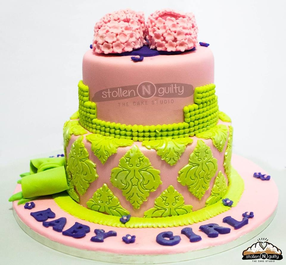 A two-tiered cake with a more matured and intricate design. Made by: Stollen N Guilty Singapore - Recommend.sg