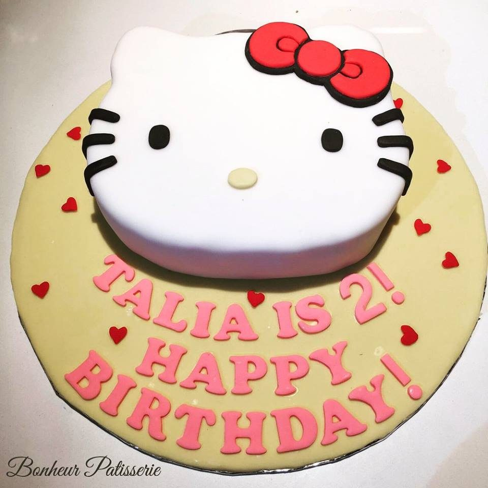 A Hello Kitty shaped cake neatly decorated with fondant to look like a Hello Kitty. Made by: Bonheur Patisserie. Source