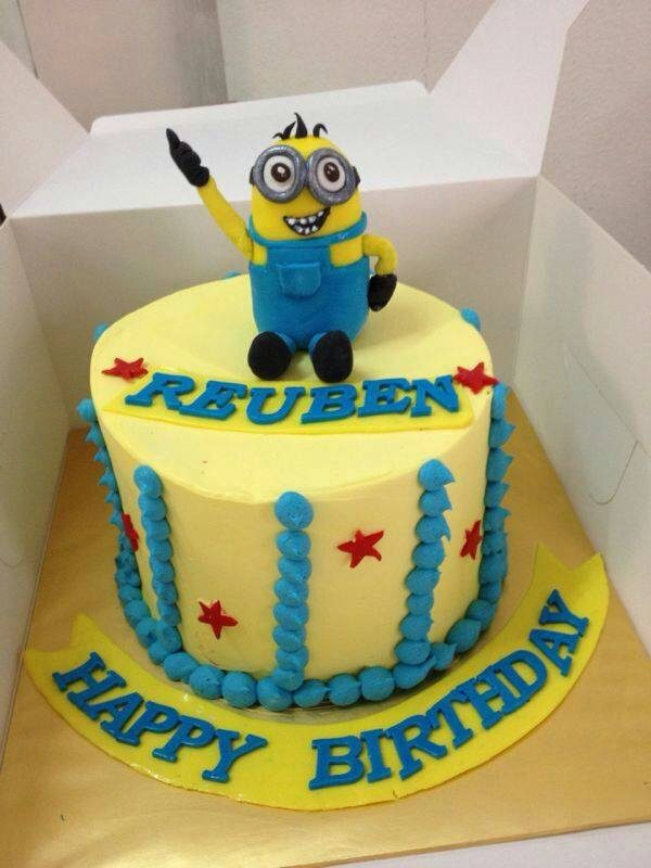 A tall round cake with yellow and blue buttercream frosting with an edible Minion cake topper.Made by:My Fat Lady Cakes and Bakes.Source