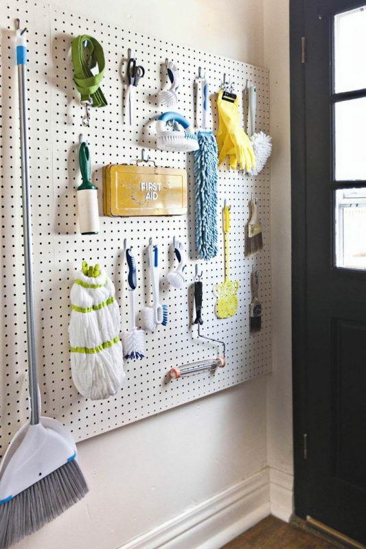 Install a pegboard on one wall to hang tools and make it a multipurpose space