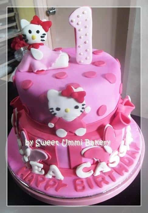 Stacked, round-shaped pink cake with dotted fondant decoration on its covering seems cuter with an addition of pink bow around its side. Made by: Sweet Ummi Bakery .Source