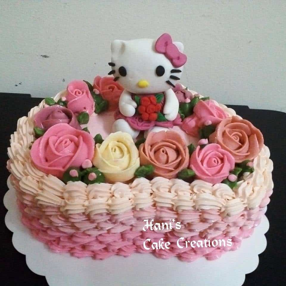 Heart-shaped cake with rose buttercream frosting on top will make your Hello Kitty topper looks like it sits comfortably in a flowery garden. Made by:  Hani's Cake Creations.Source