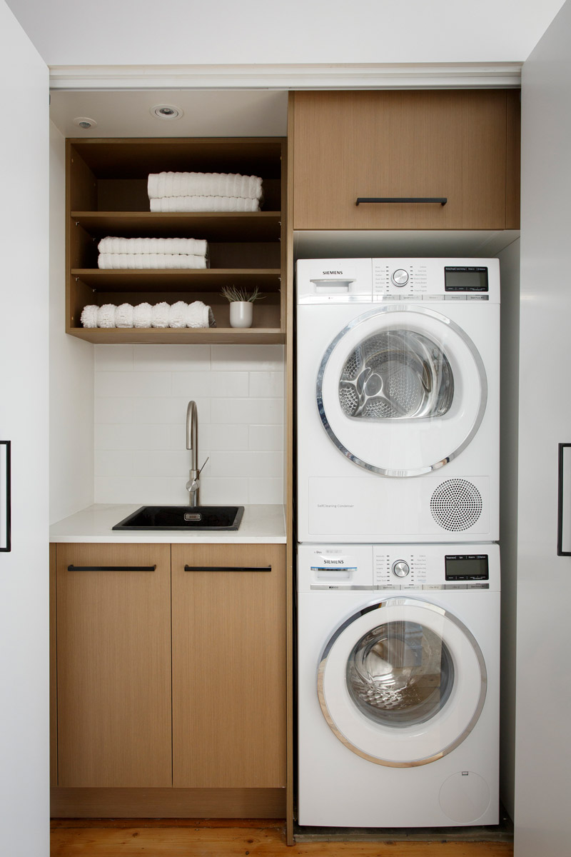 Stack upwards: Put your dryer above the washing machine (ideally, you should use a shelf to separate them)