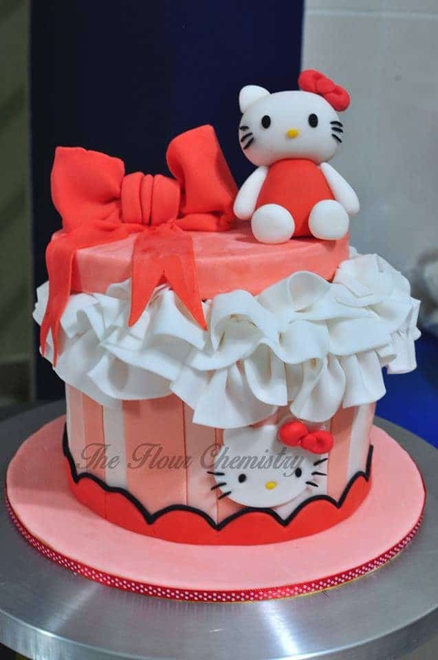 Redder tones in this Hello Kitty cake works for those who don't prefer pink. Made by:  The Flour Chemistry .Source