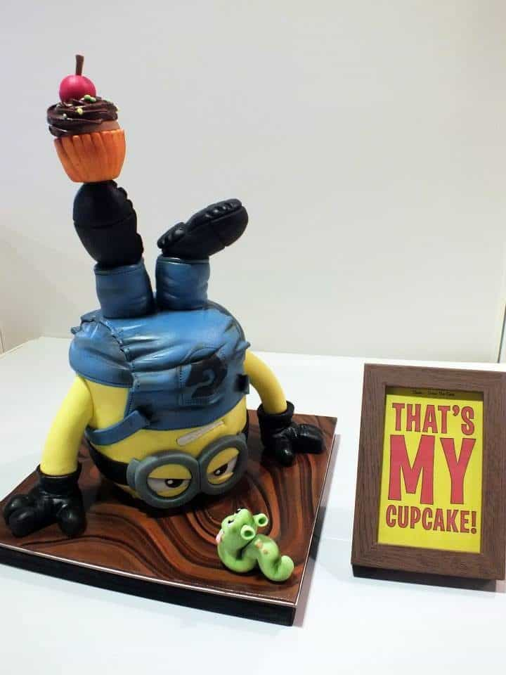 An upside down 3D Minion cake made of gum paste and fondant is just too creative!. Made by: The White Ombre.Source