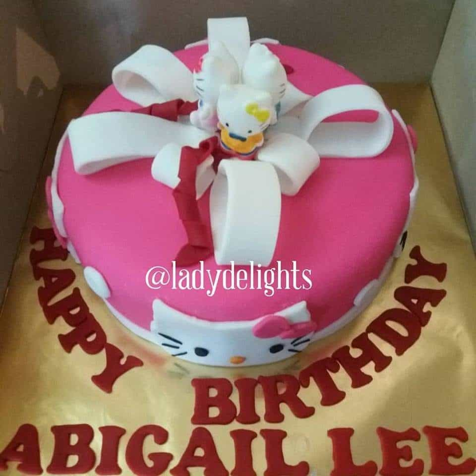 A simple round cake with fondant decoration and a group of three Hello Kitty toppers.Made by: Ladydelights Bakery .Source
