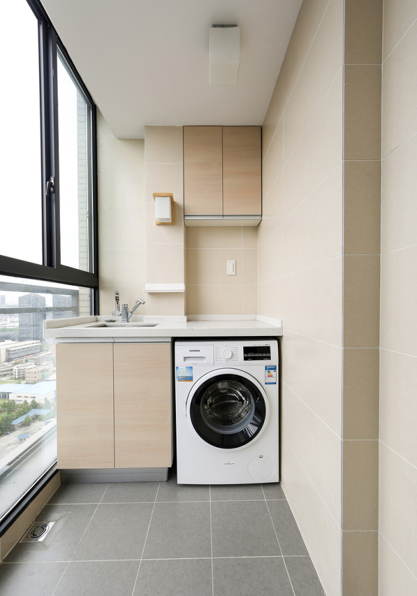 Add a counter above the washing machine to create folding space