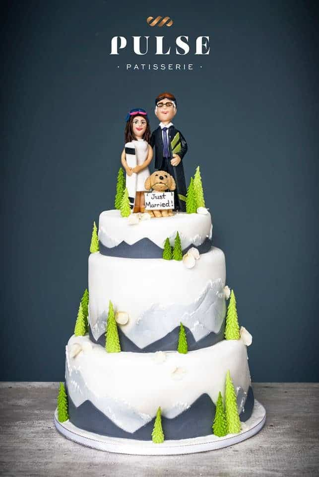 A simple yet unique wedding cake design that incorporates the personalities of the newlyweds. Made by: Pulse Patisserie.Source