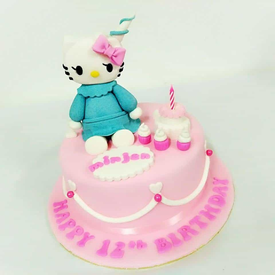 A round cake covered with soft pink fondant icing and simple design is a nice base for a medium size Hello Kitty topper. Made by : Eats & Treats Bakery.Source