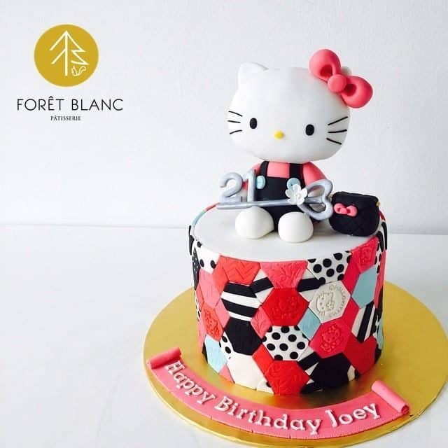 Want a Hello Kitty themed cake but don't want it to be too feminine? Adding a bit of black like the cake below might be a good alternative. Made by: Foret Blanc Patisserie.Source