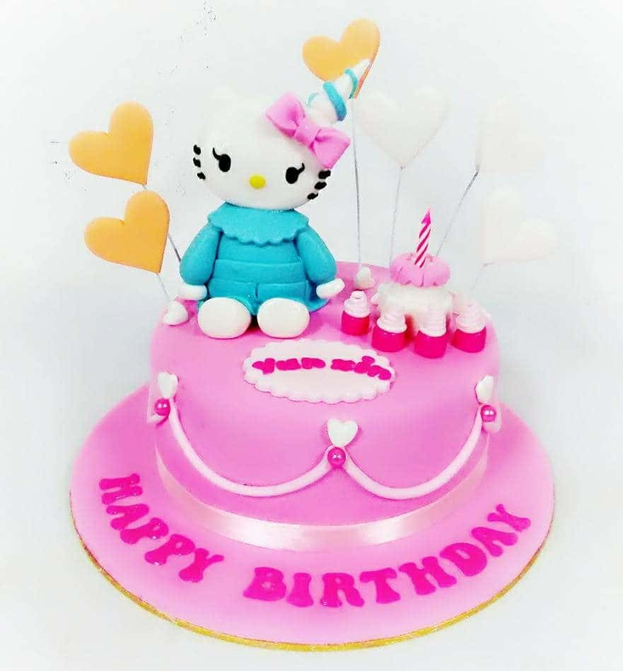 Heart-shaped fondant stick toppers and metallic ribbons can also be a good addition for your round Hello Kitty cake. Made by : Eats & Treats Bakery.Source
