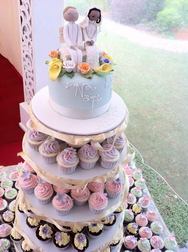 A multi-tiered cake stand that combines cupcakes with buttercream frosting and a fondant cake on the top tier makes this arrangement looks so much fun. Made by: My Fat Lady Cakes and Bakes.Source