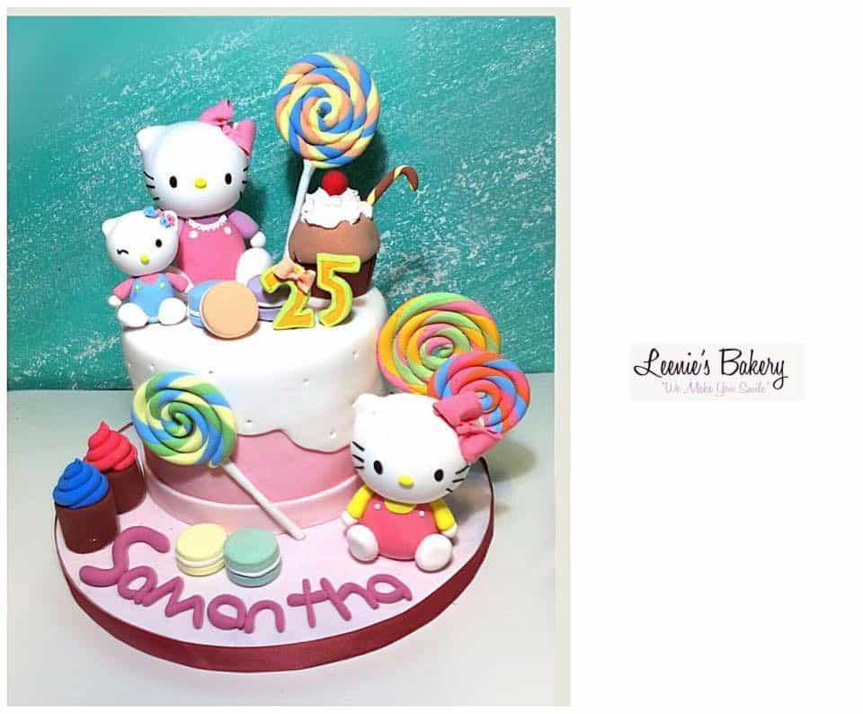 This cake strikes a playful mood with double layered fondant icing cake decorated with plenty of Hello Kitty figures and candy toppers. Made by: Leenie's Bakery.Source