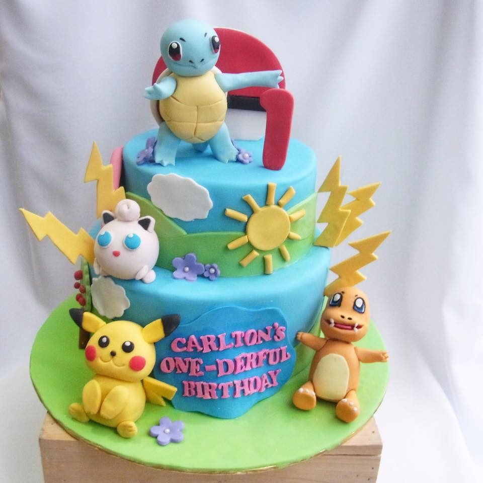 A two-tiered Pokemon cake neatly wrapped with fondant and decorated with edible Squirtle, Jigglypuff, Pikachu and Charmander. Custom cake by Corine & Cake.Source
