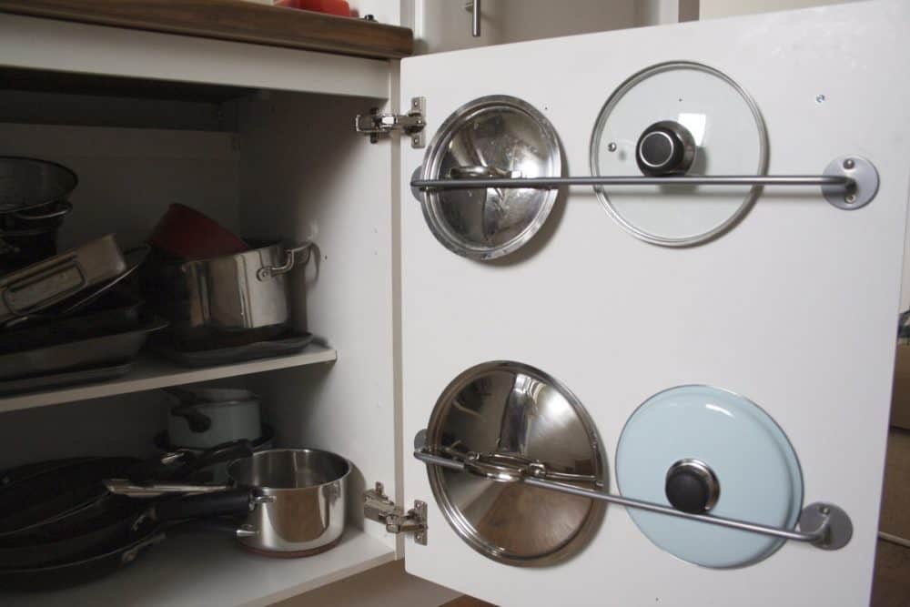 Ikea hack cabinet rail for pot covers. Source: apartmentapothecary.com