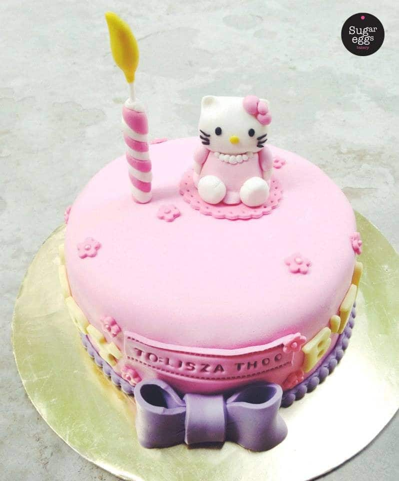 A low, one-tiered round cake is perfect for birthday with a artificial candle and a little Hello Kitty topper.Made by: Sugareggsbakery.Source