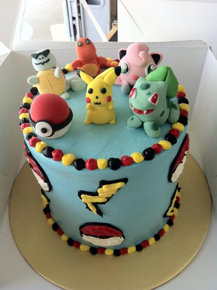 A tall round cake with buttercream frosting and 3D Pokemon characters made of fondant. Custom cake by My Fat Lady Cakes and Bakes.Source