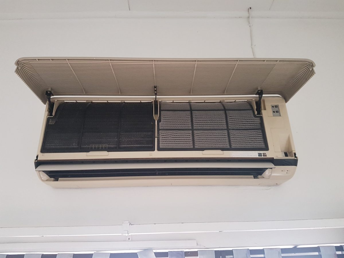 See the difference? One the left, a clean aircon filter. now that you know how to clean your air conditioner, you can clean the other side.