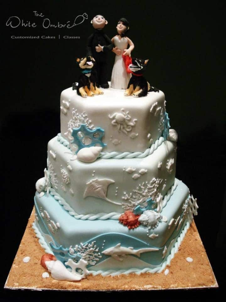 A unique three-tiered hexagon shaped cake with under-the-sea themed detailings. Made by: The White Ombre.Source