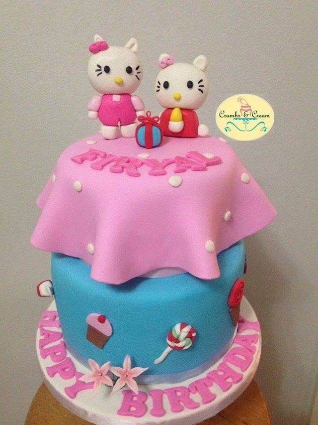 This two-tiered cake with a unique, flared fondant icing and medium-sized Hello Kitty toppers will make the best centrepiece for your party. Made by: Crumbs & Cream.Source