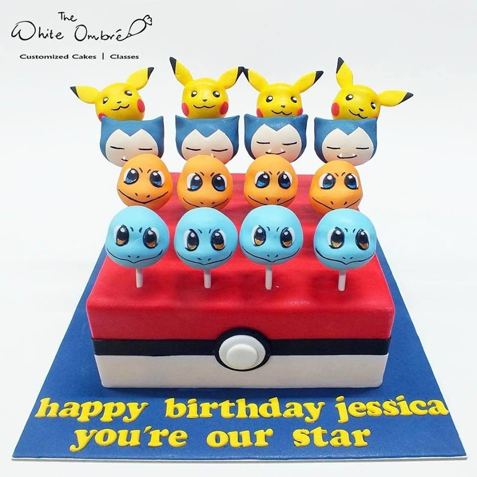 A two-in-one centrepiece with a square cake with Pokeball design as base and cake pops with Pokemon characters as the topper means more share for everyone!. Custom cake by The White Ombré . Source