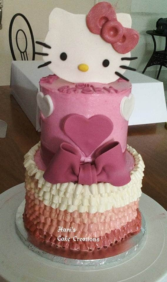 Combining fondant and buttercream for topping and icing like in this two-tiered cake decoration. Made by:  Hani's Cake Creations.Source