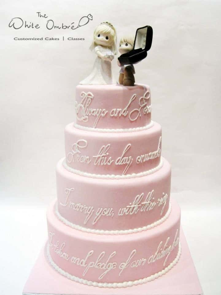 A hopelessly romantic wedding cake with wedding vows written on side of the cake is just perfect. Made by: The White Ombre.Source