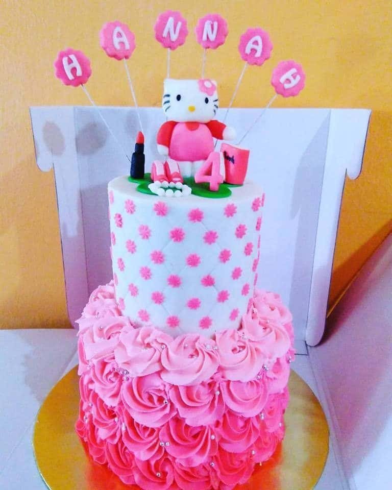 A beautiful, tall, round-shaped cake with huge rosy icing beneath looks even more complete with a 3D Hello Kitty topper, and few stick toppers to write your kids' name. Made by: Suez Cakes. Source