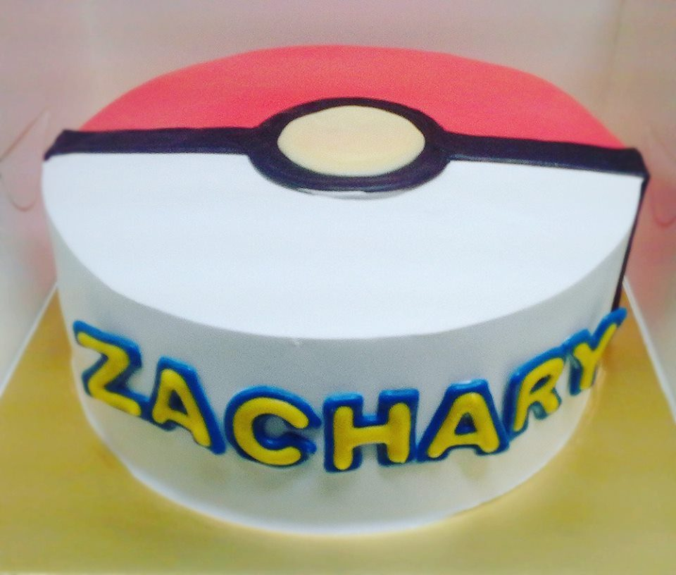 A regular round Pokemon cake turned into a Pokeball with white, red and black buttercream. Custom cake by Naomi Kitchen.Source