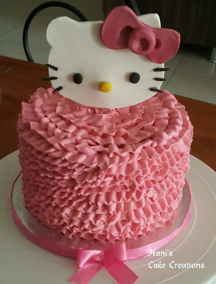 A round, single tier cake fully covered with ruffle buttercream icing with big Hello Kitty fondant cutout on top. Made by:  Hani's Cake Creations.Source